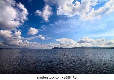 seascape. seacoast and fantastic blue cloudy sky