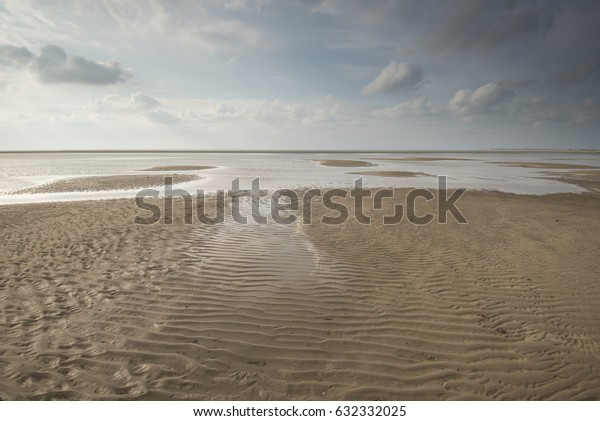 Seascape with small sandbanks at low tide