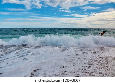Seascape with snow-white waves in a bright sunny day in Calella, Spain.