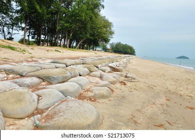 Seascape of Songkhla beach and big bag wall on beach at Songkhla, Thailand.