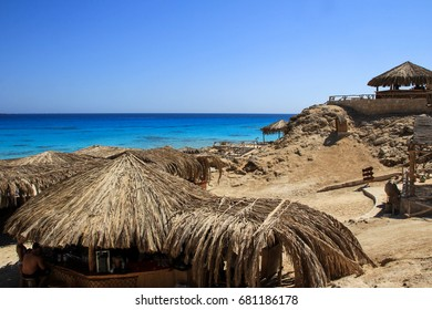 Seascape with straw umbrellas and horizon line. Tourism in Egypt, May 2012.
