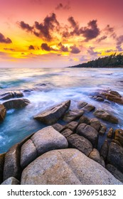 Seascape in sunset at Mae Rumphueng Beach, Rayong in Thailand. The photo was taken with a long exposure.