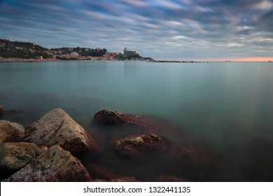 seascape with transparent sea cloudy sky and Lerici castle in the background
