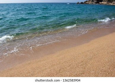 Seascape with transparent water and sandy beach