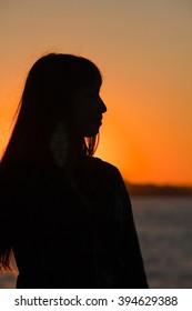 seascape Travelers silhouettes on a pier in a golden sunset island Russian city of Vladivostok Primorsky Krai