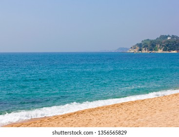 Seascape with turquoise water and sandy beach