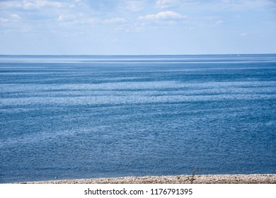 Seascape view with calm blue water in summer season in the Baltic Sea