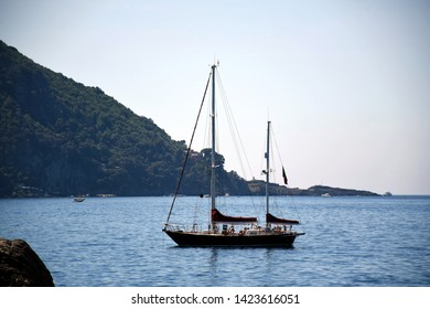 Seascape view with a sailing boat in Camogli, Italy
