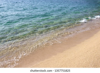 Seascape with waves and sandy beach