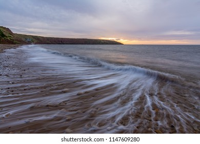 seascape with waves trails. soft focus due to slow shutter to show the waves movement. Filey beach, North Yorkshire, England.