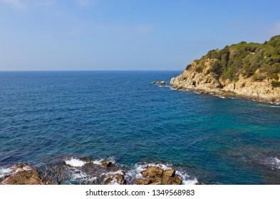 Seascape wirh rocks in Lloret de Mar, Catalonia, Spain