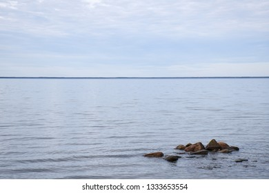 Seascape witth stones in a calm water by the coast of the swedish island Oland in the Baltic Sea