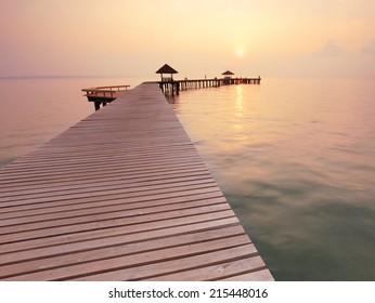 seascape and the wooden bridge on summer morning