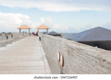 Seascape. Wooden pier with gazebos with orange roofs. Summer background. Ken Combs Pier, Gulfport, MS, USA