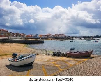 Seasfront and boardwalk of Campo fishing harbor in Arousa Island, Galicia, Spain