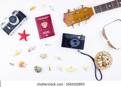 seashells with a guitar and a camera on a white background