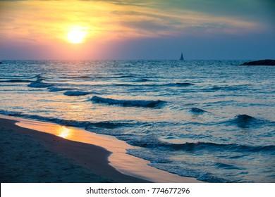 Seashore in evening. Beautiful sunset over sea