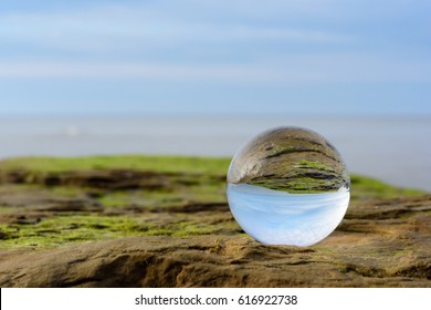Seashore is reflected inside the crystal ball