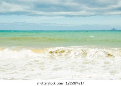 seashore. sandy beach. sunny summer day. blue water