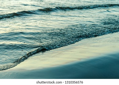 Seashore and waves at sunset. Calmness, awareness, the path to yourself. Harmony and life without stress