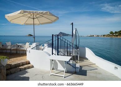 Seaside bar terrace in traditional Mediterranean color on Altea  bay, Costa Blanca, Alicante,  Spain