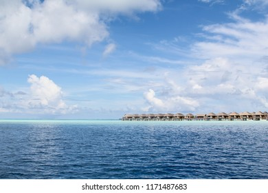Seaside bungalows on a shallow reef in a luxury resort in the Maldives