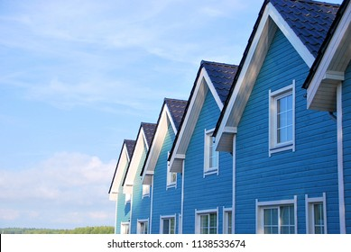 Seaside cottage. New house for rent. Row of beach rentals. Blue seaside house.