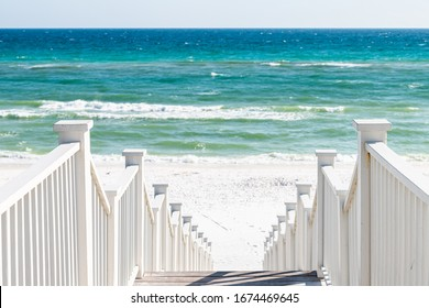 Seaside, Florida railing wooden stairway walkway steps architecture by beach ocean background view down during sunny day