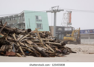 SEASIDE HEIGHTS, NJ - JAN 13: Wooden planks piled up on the beach on January 13, 2013 in Seaside Heights, New Jersey. Clean up continues 75 days after Hurricane Sandy struck the shore in October 2012.