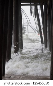 SEASIDE HEIGHTS, NJ - JAN 13: Waves break against the submerged Casino Pier Star Jet roller coaster and pilings on January 13, 2013 in Seaside Heights, NJ. Hurricane Sandy made landfall 75 days ago.