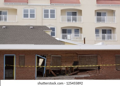 SEASIDE HEIGHTS, NJ - JAN 13: An older building destroyed by Hurricane Sandy in October 2012 with a newer apartment complex in the background on January 13, 2013 in Seaside Heights, New Jersey.