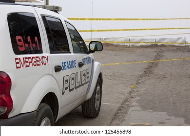 SEASIDE HEIGHTS, NJ - JAN 13: A police vehicle and yellow caution tape block the entrance to the beach for the public's safety on January 13, 2013 in Seaside Heights, New Jersey.