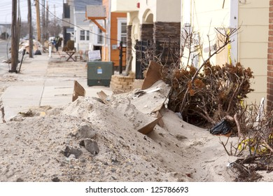 SEASIDE HEIGHTS, NJ - JAN 13: Sand and debris block a sidewalk on January 13, 2013 in Seaside Heights, New Jersey. Clean up continues 75 days after Hurricane Sandy struck the shore in October 2012.