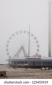 SEASIDE HEIGHTS, NJ - JAN 13:The FunTown Pier Giant Ferris Wheel in the fog on January 13, 2013 in Seaside Heights, New Jersey. Clean up continues 75 days after Hurricane Sandy struck in October 2012.