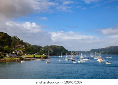 Seaside houses and anchored sailboats at Oban Bay. Oban is popular a resort town and ferry terminal in Argyll and Bute, Scotland, UK,