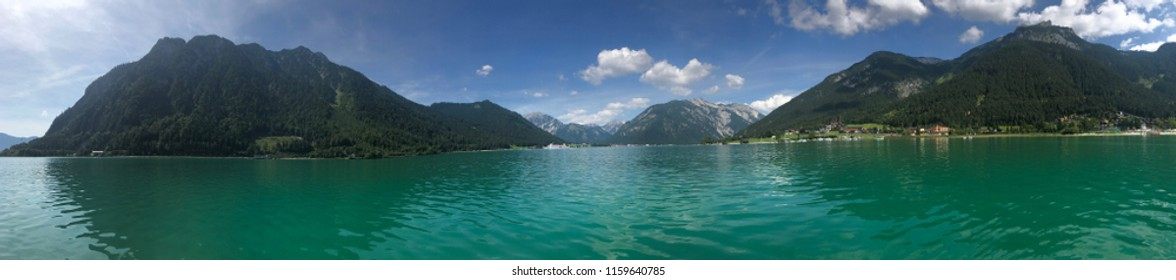 Seaside and mountain panorama on a sunny day with blue sky at the famous Lake Achen in Tirol, Austria