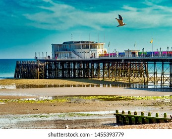 Seaside Pier; small English pier at dusk
