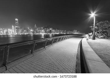Seaside promenade and skyline of Hong Kong city at night