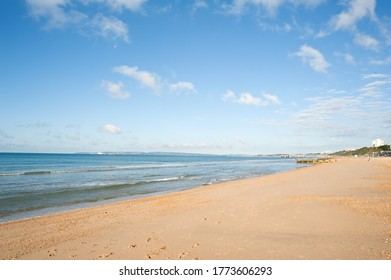 seaside resort of bournemouth in the uk nice sunny day with blue sky a few clouds and colour in the sea