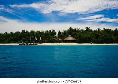 a seaside resort on a island in the mentawai, west sumatra, indonesia