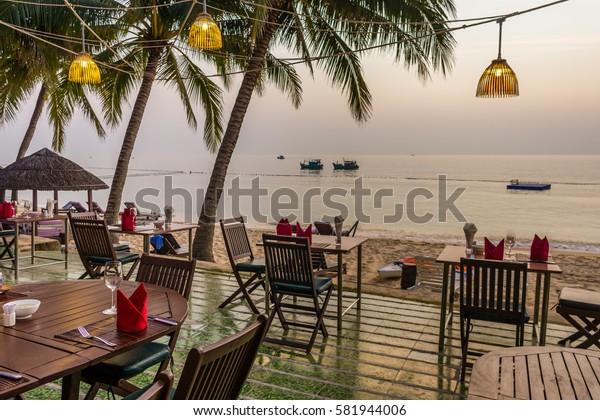 Seaside restaurant in the twilight, a terrace at Saigon resort, Puh Quoc, Vietnam, Jan 24, 2014,
