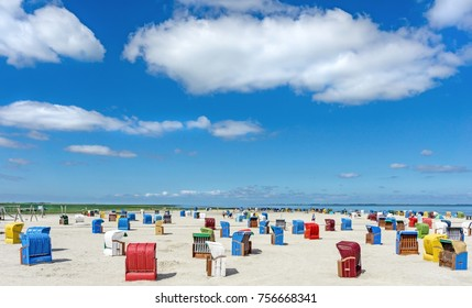 A seaside scene with colourful chairs on the beach in Germany