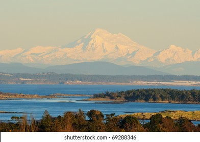 seaside sunset scene with mountain baker on the background at sunset moment, victoria, vancouver island, bc, canada