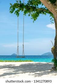 Seaside swing under the tree at Nyaung Oo Phee island in Myanmar