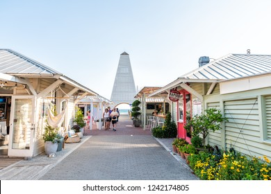 Seaside, USA - April 25, 2018: Shopping mall park square center in historic city town beach village during sunny day in Florida panhandle, white architecture, people, Obe pavilion tower