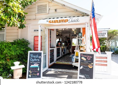 Seaside, USA - April 25, 2018: Seafood restaurant sign for Shrimp Shack in historic city town beach village during sunny day in Florida panhandle gulf of mexico entrance