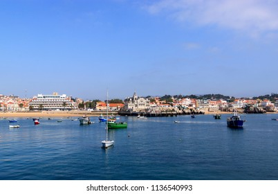 Seaside view of Cascais. A suburb of Lisbon, Portugal. Resort on the Atlantic coast. Boats on the water. Summer sunny day.