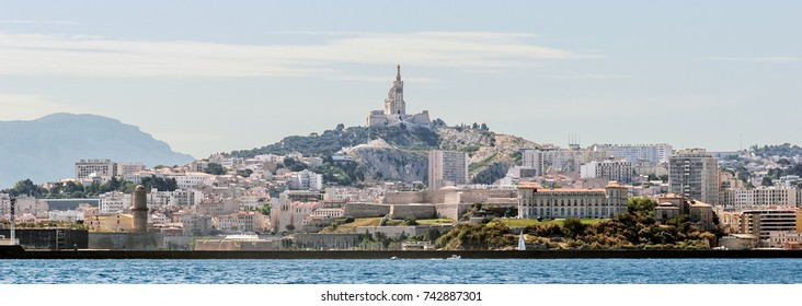 "Seaside view of the city of Marseille and the historic church ""Notre Dame de la Garde"" in South France"