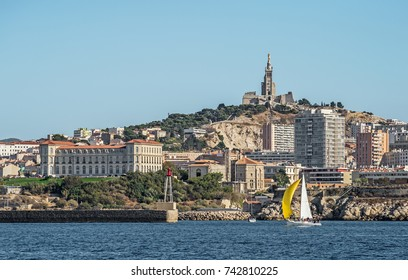 "Seaside view of Marseille with its church ""Notre Dame de la Garde"" and the old palace ""Villa Pharo"" in South France"