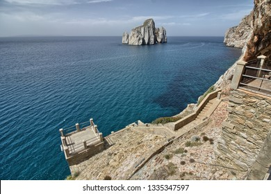 Seaside view of Pan di Zucchero and sea stacks of Masua from Porto Flavia minery. Sardinia, Italy